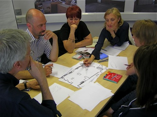 Group 2 discuss furniture and layout ideas for their teaching room design.jpg