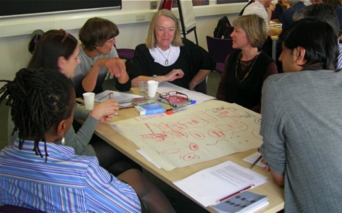 Group 1 develop their ideas for a sample room.jpg